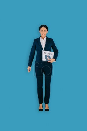 top view of businesswoman with newspaper isolated on blue background