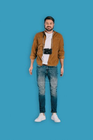 top view of stylish male photographer with camera isolated on blue background