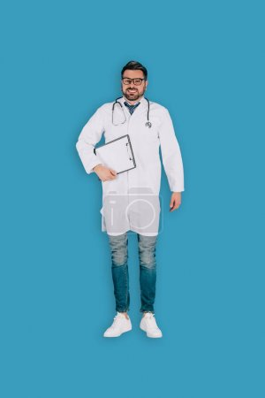 top view of male doctor with stethoscope and clipboard isolated on blue background