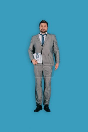 top view of businessman with newspaper isolated on blue background