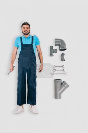 top view of plumber with spanners and pipes isolated on white background