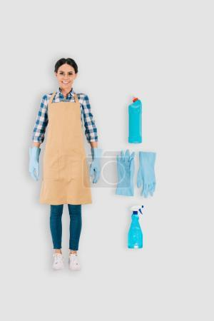 top view of female cleaner in protective gloves with spray bottle and cleaning fluid isolated on white background