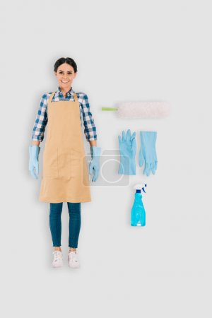 top view of female cleaner in protective gloves with spray bottle and duster isolated on white background