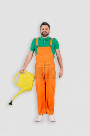 top view of male gardener with watering can isolated on white background