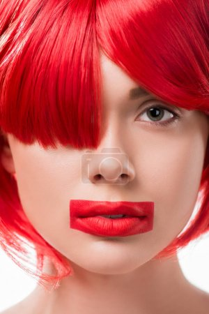 beautiful woman with red hair and red lips in shape of rectangle looking at camera isolated on white