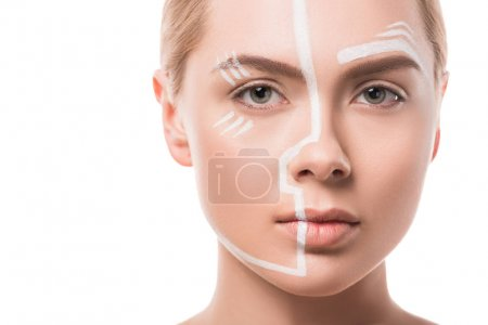headshot of beautiful woman with white lines on face looking at camera isolated on white