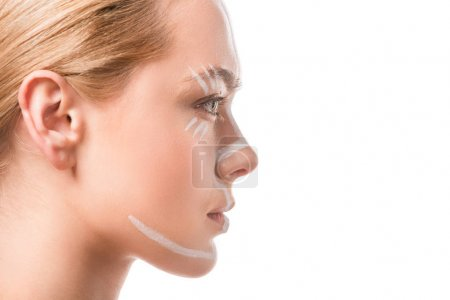 side view of beautiful woman with white lines on face looking away isolated on white, body art