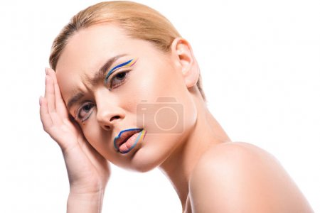 irritated woman with colored makeup with lines looking at camera isolated on white