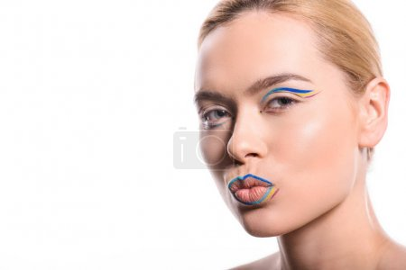 woman with colored makeup with lines grimacing isolated on white