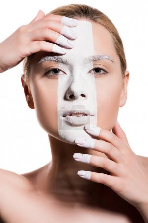 attractive woman with white paint on face touching forehead and chin isolated on white, body art