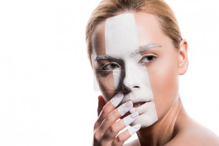 beautiful woman with white paint on face and fingers touching lips isolated on white