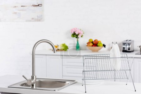 Photo for Close up of sink and stand for dishes on kitchen - Royalty Free Image