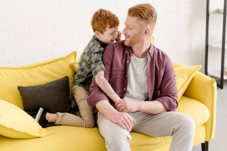 Photo for Happy father and son smiling each other while spending time together at home - Royalty Free Image