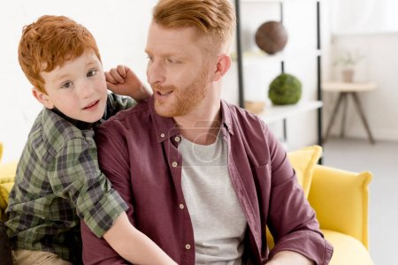 Photo for Happy redhead father and son spending time together at home - Royalty Free Image