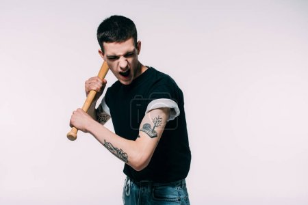 Aggressive young man with baseball bat isolated on white