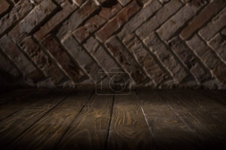 Photo for Close up view of wooden tabletop and brick wall background - Royalty Free Image