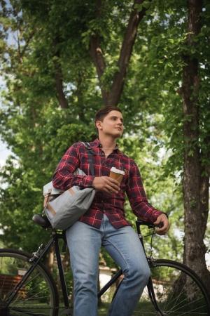 man in checkered shirt at park