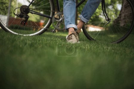 Man in jeans with bicycle