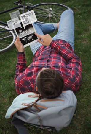 Man reading news on digital tablet