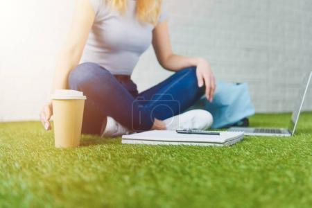 student with coffee
