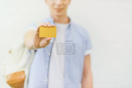 Photo for Cropped shot of young man holding golden card - Royalty Free Image