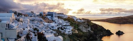 Photo for Horizontal image of white houses on greek island near sea in evening - Royalty Free Image