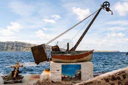 Photo for SANTORINI, GREECE - APRIL 10, 2020: aged and rusty boat with bell marine hellas lettering near sea in greek island - Royalty Free Image