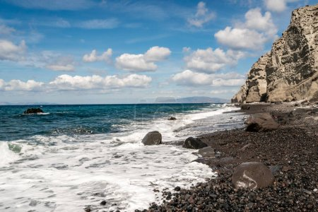 Photo for Blue aegean sea near rocks against sky with clouds - Royalty Free Image