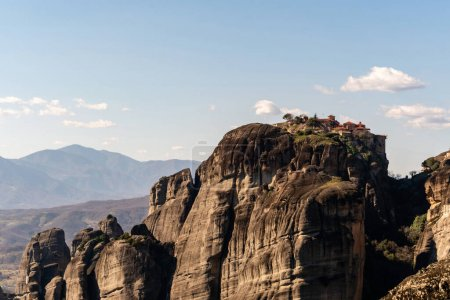 Photo for Monastery on rock formations near mountains in meteora - Royalty Free Image