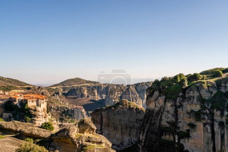 Photo for Orthodox monastery on rock formations against blue sky in meteora - Royalty Free Image