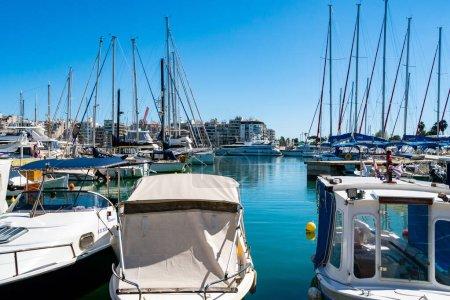 PIRAEUS, GREECE - APRIL 10, 2020: docked yachts in aegean sea against blue sky