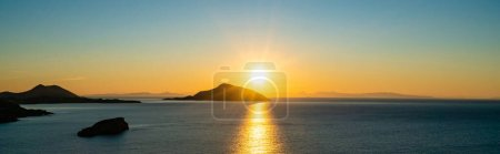 Photo for Panoramic concept of sunset near scenic aegean sea in greece - Royalty Free Image