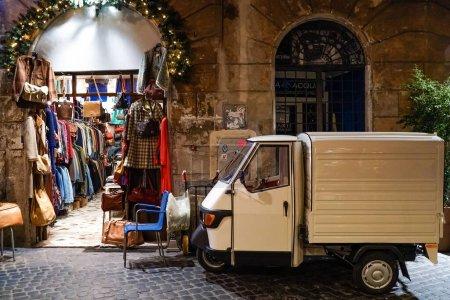 Photo for White car near clothing shop on italian street - Royalty Free Image