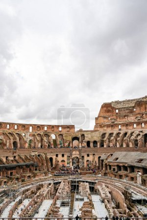 ROME, ITALY - APRIL 10, 2020: historical Colosseum against sky with clouds in rome