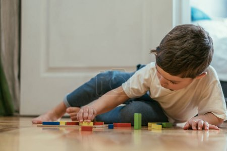 Photo for Selective focus of cute toddler kid playing with toys on floor - Royalty Free Image