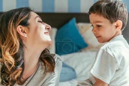 Photo for Cheerful mother looking at cute toddler son - Royalty Free Image