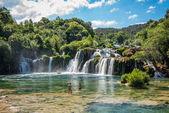 Tourists swim at waterfall Skradinski Buk in Krka National Park ,one of the Croatian national parks in Sibenik,Croatia,27 May 2017