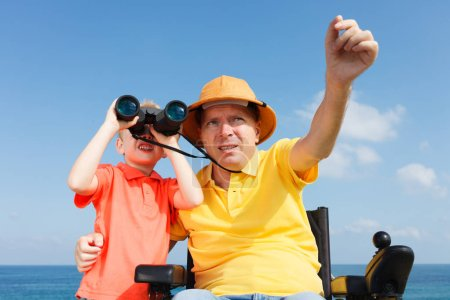 Father and son with binocular