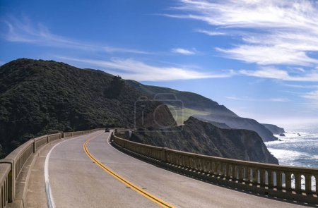 Bixby Bridge road trip with yellow lines and curve