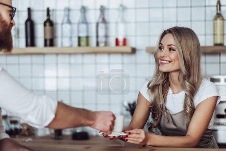 Female barista and customer