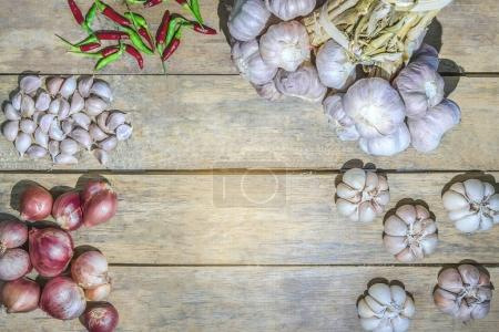 Thai herbal vegetable plants on wooden floor