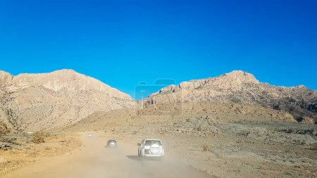 Travel by car and adventure through the dust to the mountain