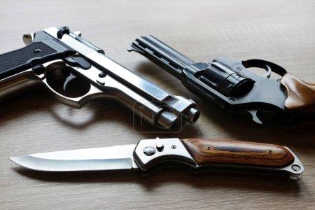Black revolver pistols with knife
