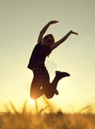Young happiness woman jumping high
