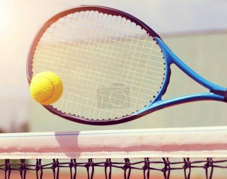 Tennis racket with ball.