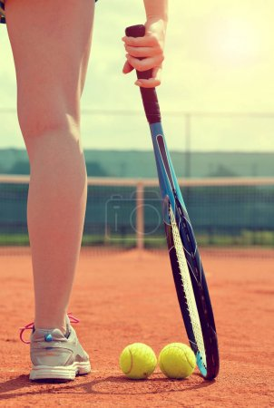 Tennis player with racket.