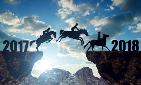 The riders on the horses jumping into the New Year 2018.