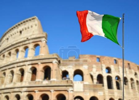Italian flag with Flavian Amphitheatre or Colosseum in the background.