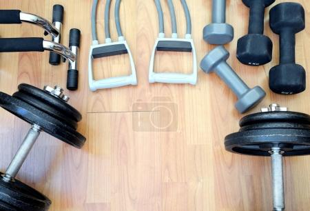 Dumbbells and elastic exercise band for fitness training.