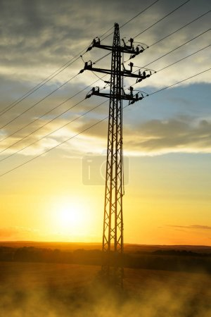 Photo for High voltage power pylon at sunset. Electricity distribution station. - Royalty Free Image